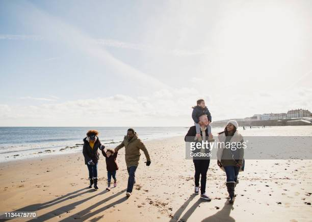 out for a walk on the beach - whitley bay stock pictures, royalty-free photos & images