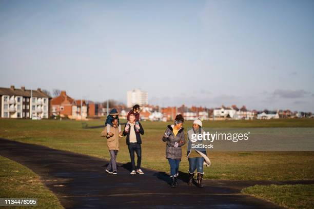 out for a winter stroll - whitley bay stock pictures, royalty-free photos & images