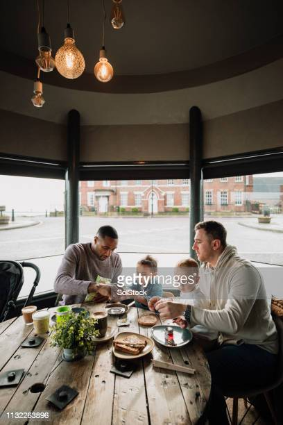 out for brunch in a cafe with friends - paternity leave stock pictures, royalty-free photos & images