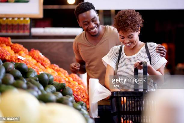 out for the weekly grocery shopping - market retail space stock pictures, royalty-free photos & images