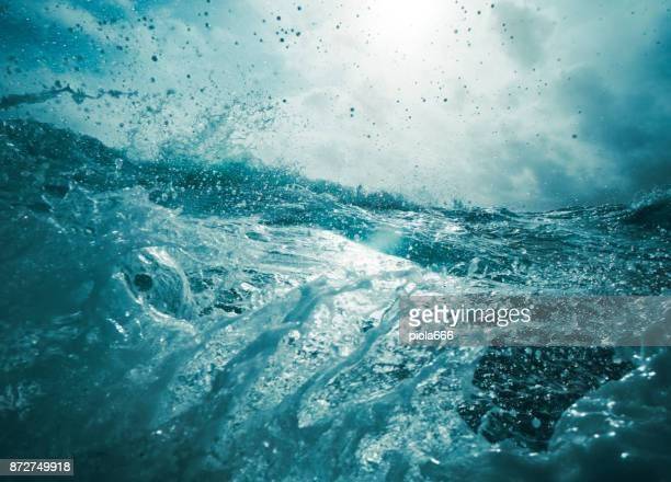 out in a rough sea - wave stock pictures, royalty-free photos & images