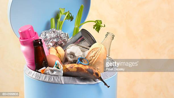 out of date rotting food in dustbin - food contamination stock photos and pictures