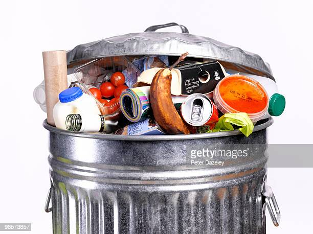 out of date rotting food in dustbin - garbage can stock photos and pictures