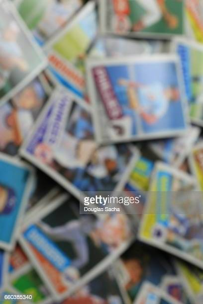 Out of focus baseball collectors trading cards