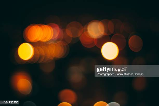 out of focus night lights on a city - basak gurbuz derman stock photos and pictures
