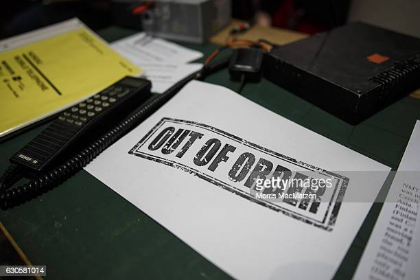 A 'Out of Order' sign is placed next to an old cell phone at the 33rd Chaos Communication Congress on its opening day on December 27 2016 in Hamburg...