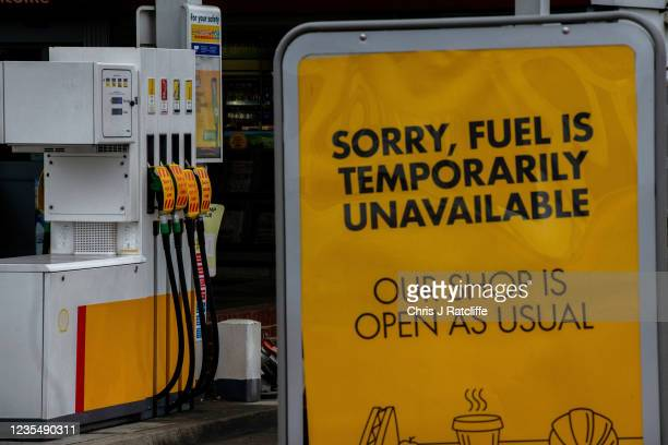 Out of service signs on fuel pumps at a Shell garage which is out of all fuel on September 25, 2021 in Grove Park, London, United Kingdom. BP and...