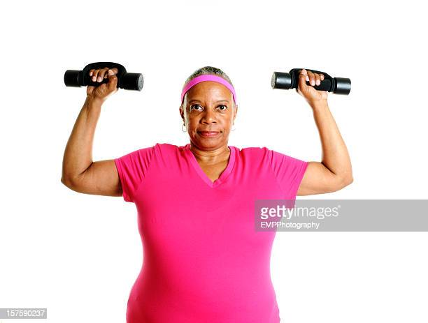 out of shape woman exercising - hand weight stock pictures, royalty-free photos & images