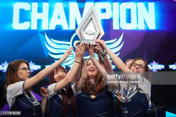 Out Of The Blue Airbus team hold their trophy after winning the League of Legends final against Besiktas during day 2 of the Girl Gamer Madrid...