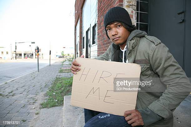 out of work vet with a hire me sign - homeless veterans stock photos and pictures