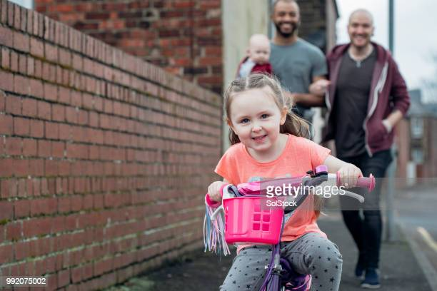 out on her bike with the family - adoption stock pictures, royalty-free photos & images