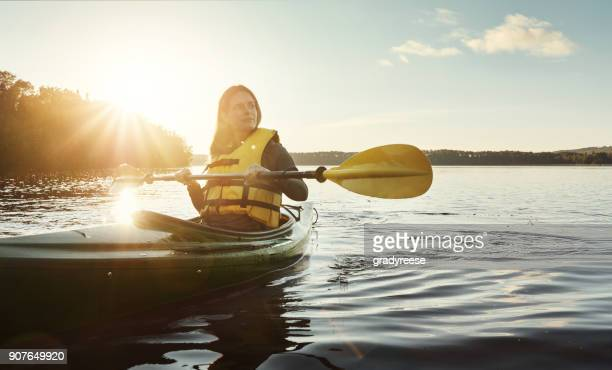 out on the water is where she comes to think - life jacket stock pictures, royalty-free photos & images