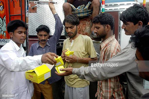 Out reach worker for the AIDS Prevention Society Moheutddin Ahmed distributes condoms to the truck drivers and handymen in the Beltola area of...