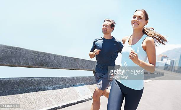 out running on a beautiful day - couples stock pictures, royalty-free photos & images