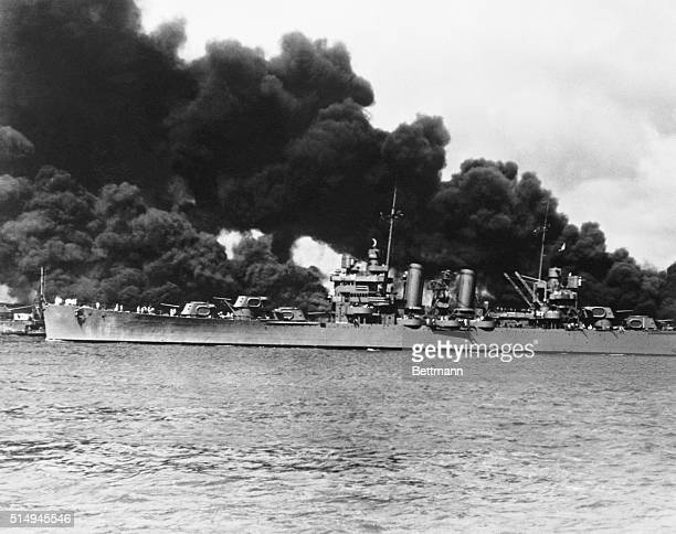 Out to Battle the Japs An undamaged light cruiser as it steamed out past the burning USS Arizona on its way to join the fleet at sea after the...