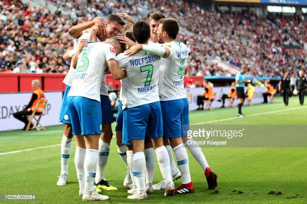 Out Weghorst of Wolfsburg celebrates the second goal with his team mates during the Bundesliga match between Bayer 04 Leverkusen and VfL Wolfsburg at...