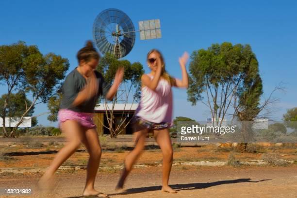 Outback Australia, dancing, barefoot dancing, holidaying outback Australia, sisters dancing, dirt dancing, enjoying outback Australia