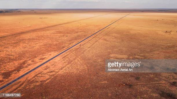 outback highway shot by drone, australia - condition stock pictures, royalty-free photos & images