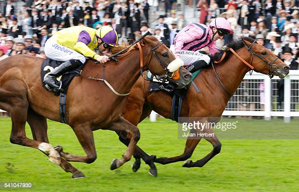 Outback Traveller ridden by Martin Harley leads Brando ridden by Tom Eaves home to win The Wokingham Stakes Race run during Day Five of Royal Ascot...