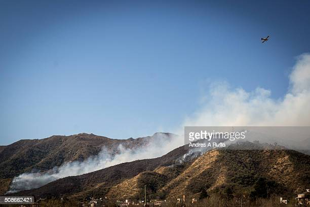 outbreak of fire in the balcony area of the commune san roque argentina working 13 fire crews and 2 firefighting planes