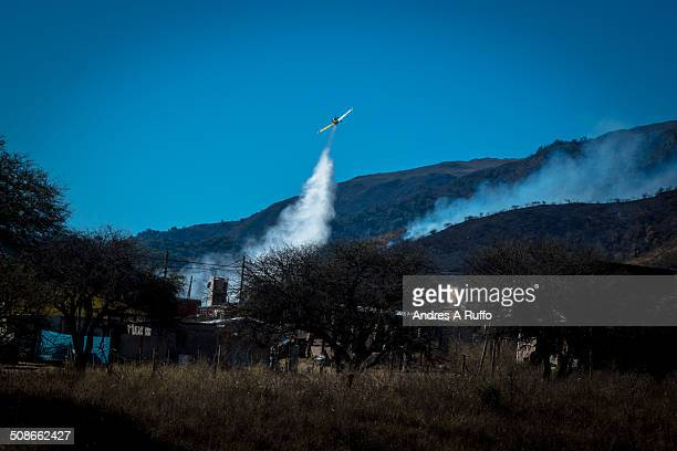 outbreak of fire in the balcony area of the commune san roque argentine working 13 fire crews and 2 firefighting planes