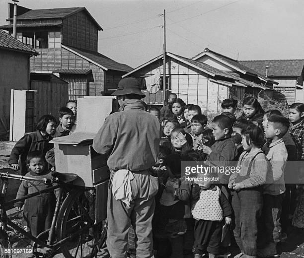 Outcaste Burakumin children in an etamura or eta town watching a Kamishibai puppet show, during the post-war Allied occupation of Japan, circa 1950.