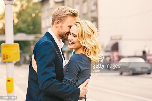 Outddor portrait of affectionate couple embracing