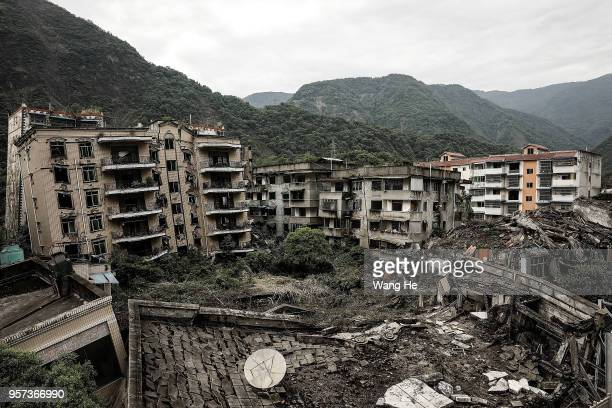 Destroyed buildings at the ruins of earthquake-hit Beichuan county during the ten year anniversary on May 11, 2018 in Beichuan Qiang Autonomous...