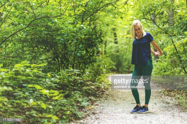 Outdoor Activities Millennial Adult Female Hiking in Nature Reserve in Mid West America