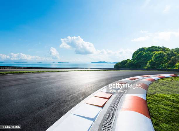 outdoor asphalt road - motor racing track stock pictures, royalty-free photos & images