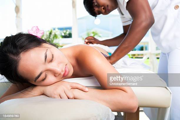 outdoor back massages - black massage therapist stock photos and pictures