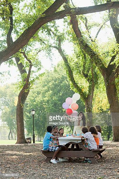 Outdoor birthday party with balloons