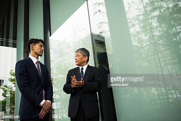 outdoor business meeting - lypsekyo16 stock pictures, royalty-free photos & images