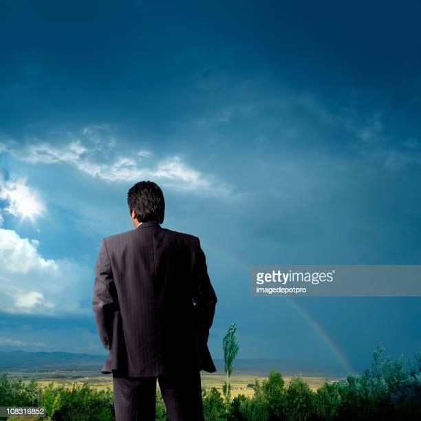 outdoor businessman thinking