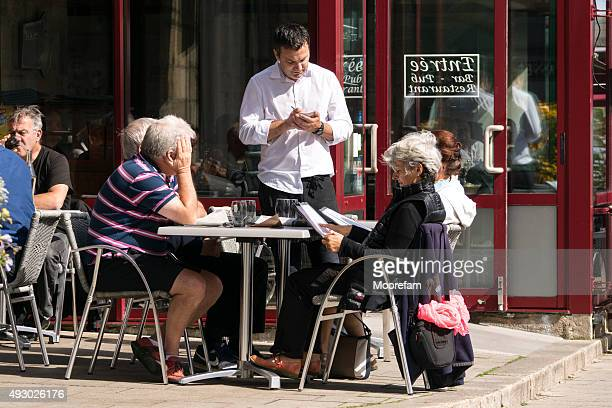 outdoor cafe by roscoff harbour in sunshine - finistere stock photos and pictures