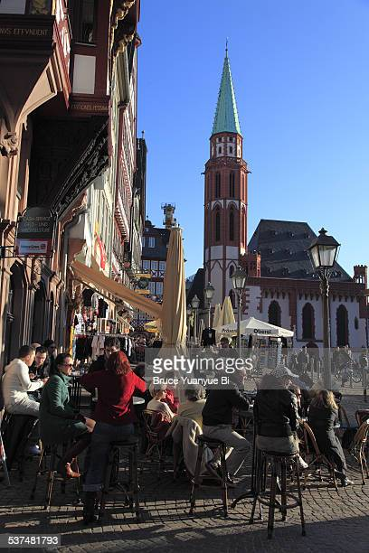 Outdoor cafe with Old St Nicholas Church