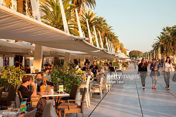Outdoor cafes at The Riva seafront promenade