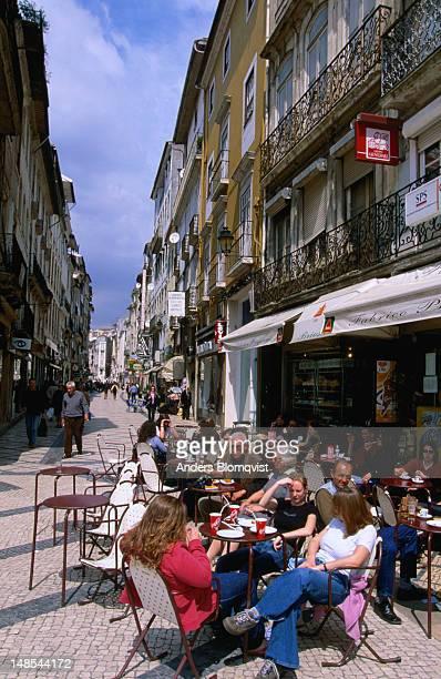 outdoor cafes on rua ferreira borges, one of the main shopping streets of coimbra. - rua stock-fotos und bilder