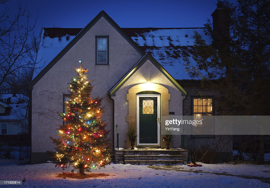 Outdoor Christmas Tree Decorated With Lights In Front Of Home ...