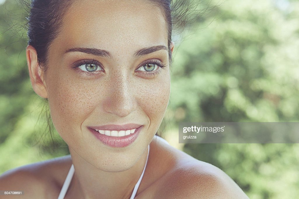 Outdoor, close-up, beauty portrait of a beautiful freckled woman : Stock Photo