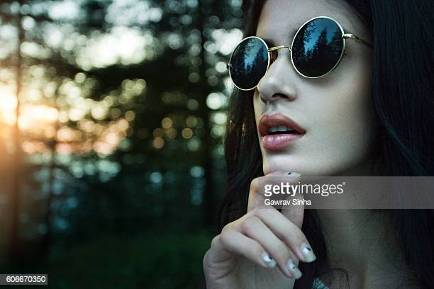 Outdoor close-up of fashionable serene young women in cool sunglasses.