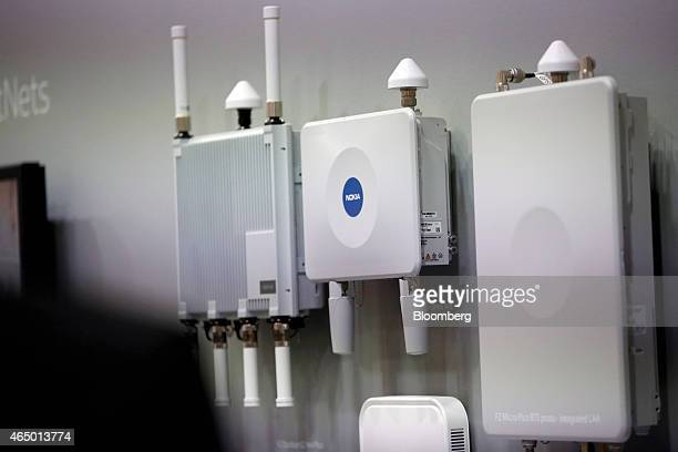 Outdoor digital network devices manufactured by Nokia Solutions and Networks sit on display in the Nokia Oyj pavilion at the Mobile World Congress in...