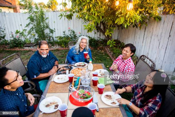 outdoor dinner on beautiful summer evening - different cultures stock pictures, royalty-free photos & images