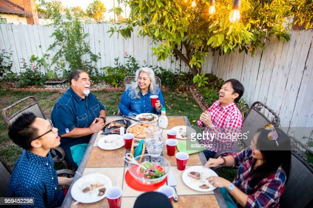 outdoor dinner on beautiful summer evening - tradition stock pictures, royalty-free photos & images