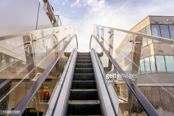 outdoor elevator. taikoo li sanlitun. - liyao xie stock pictures, royalty-free photos & images