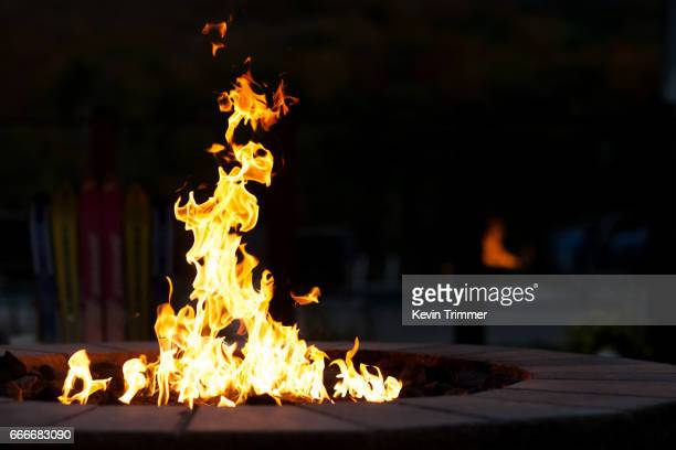 outdoor fire pit against dark background - fire pit stock pictures, royalty-free photos & images