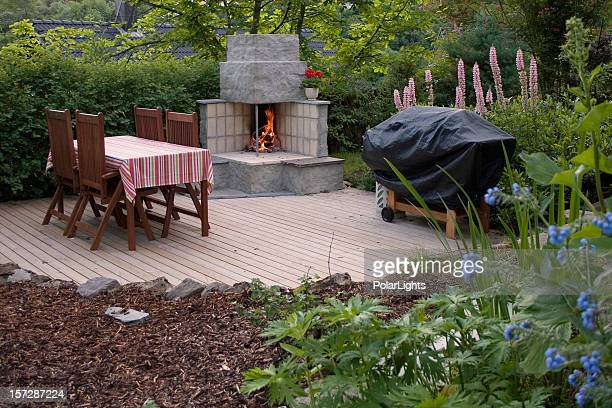 Outdoor fireplace in an idyllic garden