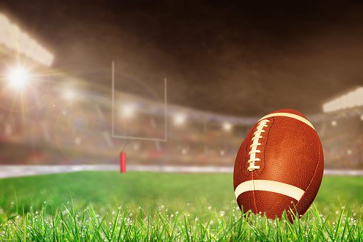 Outdoor Football Stadium With Ball on Grass and Copy Space 916727948