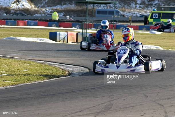 Outdoor go-kart racing with small snow piles laying around