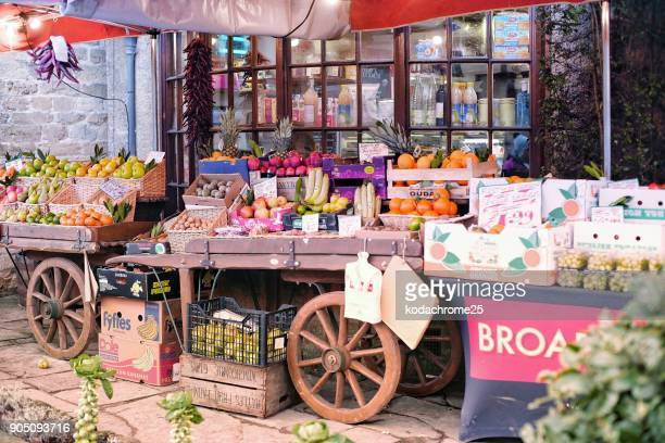 outdoor grocery greengrocers store with fruit and vegetables displayed